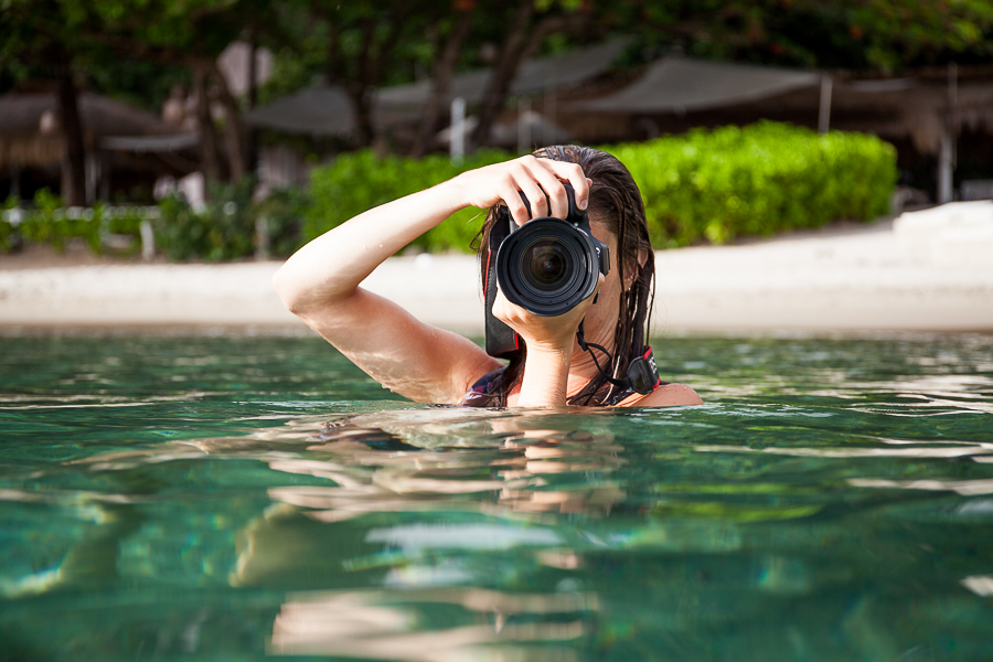 photographer in the water at sugar beach viceroy resort soufriere saint lucia